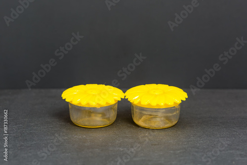 small yellow plastic flower shaped salt and pepper shakers