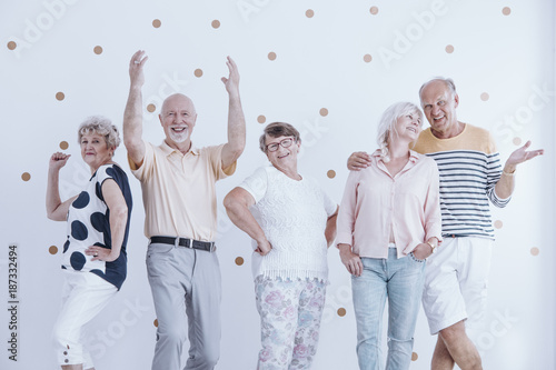 Elderly friends dancing and talking - 187332494