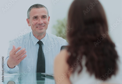qualified lawyer talking to client in a modern office