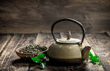 Teapot with fragrant Indian tea. - 187334087