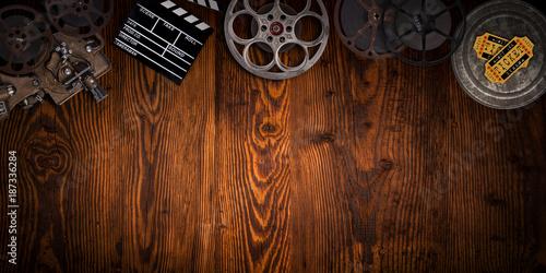 Foto Murales Cinema concept of vintage film reels, clapperboard and projector.