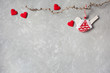 Background for congratulations on Valentines Day with red hearts, a branch, a bird