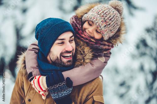 Leinwandbild Motiv Dad with daughter outdoor in winter