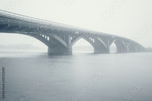 Foto op Plexiglas Kiev View of the Metro bridge and Dnieper river in dense fog, misty landscape, Kyiv the capital of Ukraine, Eastern Europe