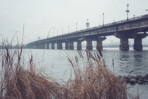 Foto op Plexiglas Kiev View of the Paton bridge and Dnieper river in dense fog, misty landscape, Kyiv the capital of Ukraine, Eastern Europe