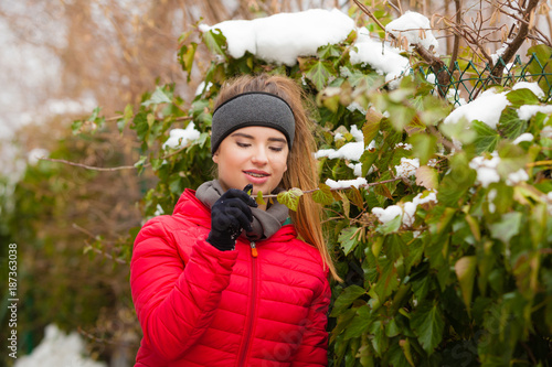 Foto Murales Woman wearing warm clothes spending time in park