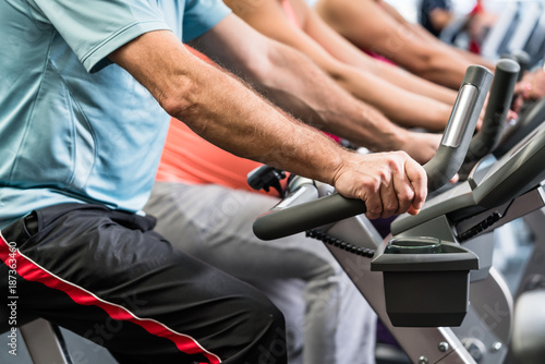 Foto Murales Group of people spinning at the gym on fitness bikes