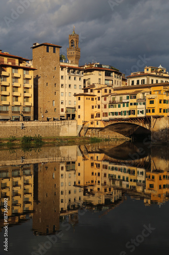Papiers peints Florence Historical buildings reflected in the Arno river in Florence, Italy