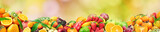 Fresh healthy fruits on natural blurred multicolored background.