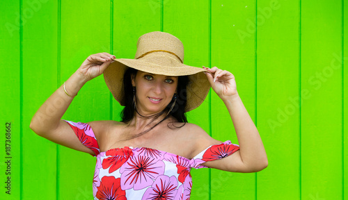 Trendy young woman in a wide brimmed straw hat - 187368662