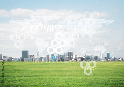 Natural background with modern cityscape green field and media interface