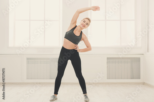 Fridge magnet Fitness woman warmup stretching training indoors