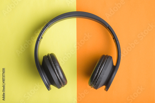 Headphones on double colorful background. - 187377658
