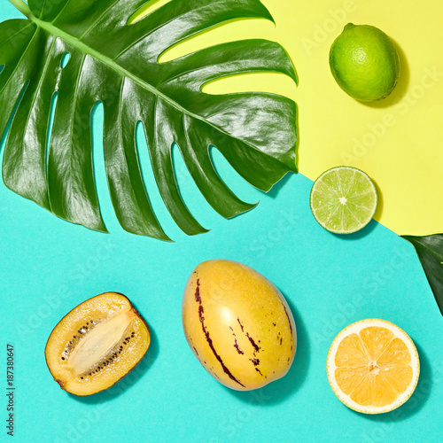 Foto Murales Tropical Palm Leaf and Fresh Fruits. Colorful Summer Trendy Design Set. Fashion concept. Creative Bright summer background, Beach. Minimal art