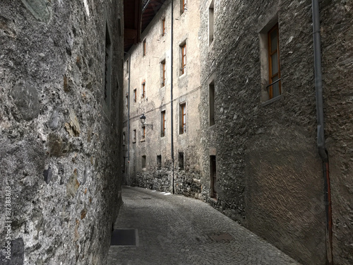 Fotobehang Smalle straatjes Empty street with stone houses in the historic old village in Bormio, Italy
