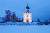 Ancient Russian Church of the Intercession on the Nerl with illumination in the winter twilight - 187389219