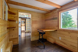 Interior design of a cozy iving room in a rustic log cabin. - 187394236