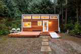 Small wooden cabin house in the evening. Exterior design. - 187394255