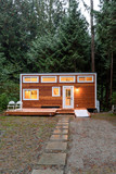 Small wooden cabin house in the evening. Exterior design. - 187394265