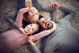 Top view of happy young family are smiling to the camera - 187394653