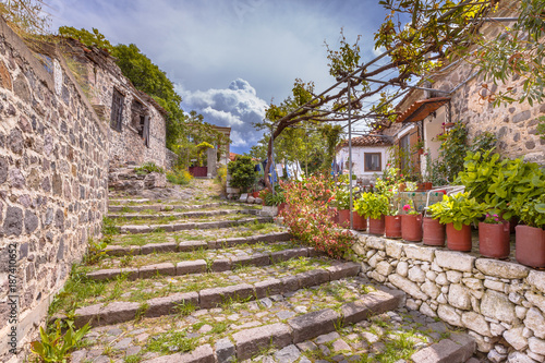 Rock alleyway staircase with gardens on Lesbos island Greece