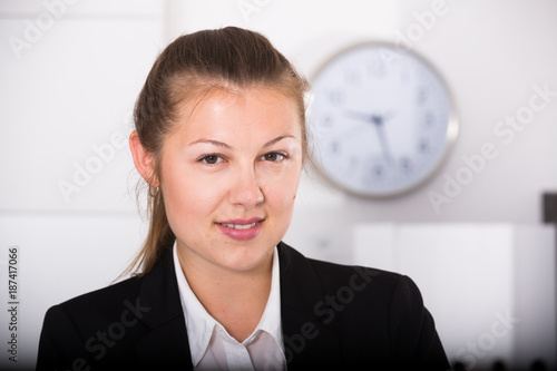 Portrait of female office manager which is working