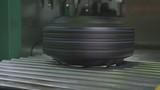 Mechanism Lowers Tire Worker Puts to Storage Closeup - 187431261