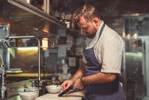 Poster Chef preparing indoors