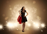 Shopping lady with bags in bright lights - 187445285