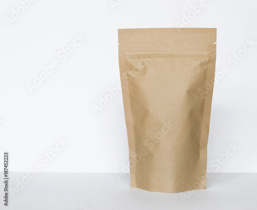 Brown paper bag on white background, eco packaging concept - 187452223