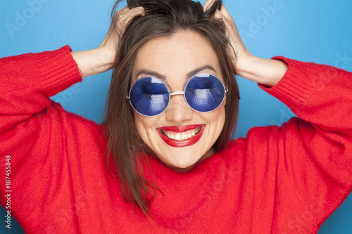 beautiful happy woman with blue sunglasses