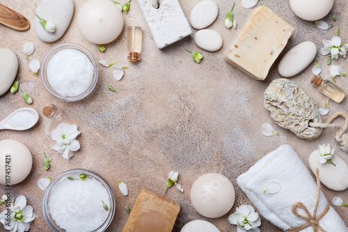 Spa and beauty threatment products background decorated flowers top view. Relax and health concept. - 187457421