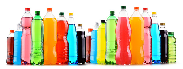 Plastic bottles of assorted carbonated soft drinks over white © monticellllo