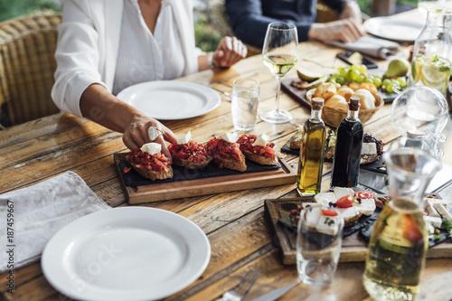 Woman Enjoying Food at Restaurant