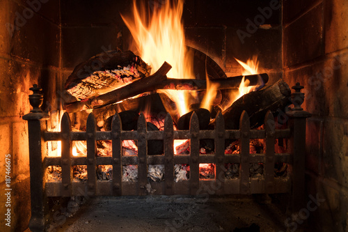 Wood Logs Fire Burning in a Traditional Country Fireplace