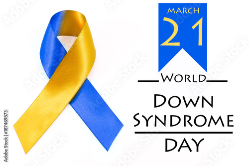 World down syndrome day with blue yellow awareness ribbon bow.