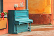 Vintage weathered aquamarine piano outdoor in the street downtown