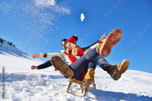 Leinwandbild Motiv romantic winter scene, happy young couple having fun on fresh show on winter vacatio, mountain nature landscape