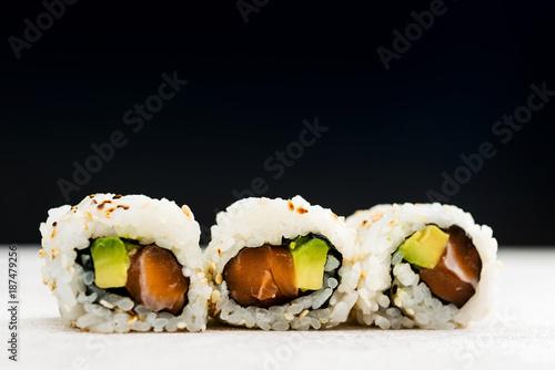 Foto op Canvas Sushi bar Japanese food Sushi Roll Maki of Salmon and avocado