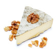 traditional french brie cheese on a white background
