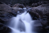 Slow Shutter Speed Photography of a Rushing Waterfall of River Rocks