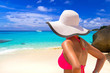Quadro Beautiful woman in white hat on the tropical beach