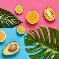 Tropical Colorful Summer Design Set. Palm Leaves and Fresh Fruits. Trendy Fashion concept. Creative Bright summer background, Beach. Minimal art. Flat lay.
