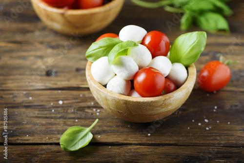 Italian antipasto with mozzarella, tomato and basil - 187505886