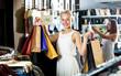 Girl having shopping paper bags in hands