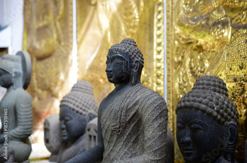 Poster Boeddha Stone statue of meditating Buddha in Gangaramaya temple, Colombo, Sri Lanka