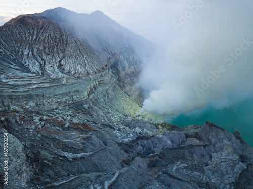 Fotobehang Blauwe hemel Aerial view from drone to Kawah Ijen volcano crater with sulfur fume. Banyuwangi, East Java, Indonesia