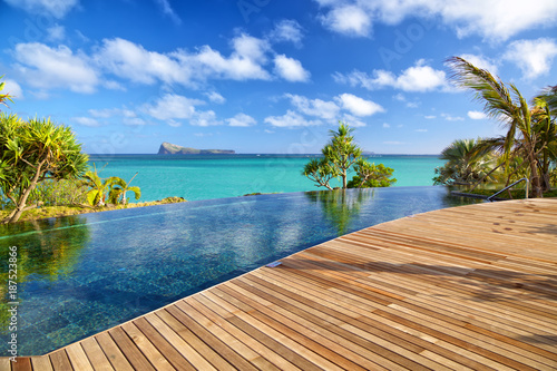 Luxury resort with swimming pool and wooden deck