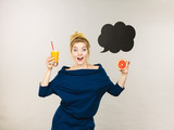 Happy woman holding fresh orange juice - 187548257