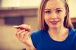Woman having healthy breakfast eating sandwich